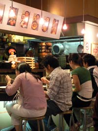Diners inside Kura in Sydney