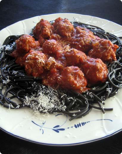 Lamb meatballs on sepia colored spaghetti