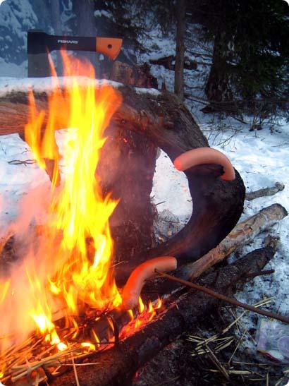 Grilling Saunawurst on a campfire
